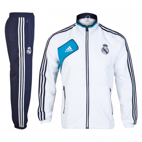 e6bf4353527de Consigue el chándal oficial Adidas del Real Madrid. Chandal a dos piezas.  Chaqueta blanca con detalles en azul marino y turquesa y pantalones en azul  marino ...